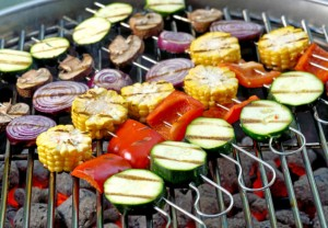 Mixed vegetable skewers on a hot barbecue